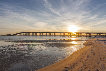 Aluminium Prints Sea biloxi sunset bridge