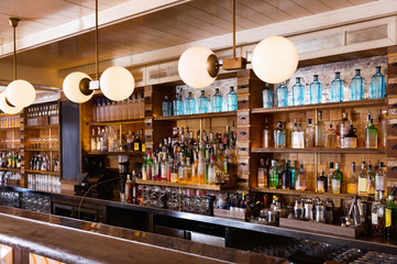 Photo of luxurious bar in night restaurant indoor.