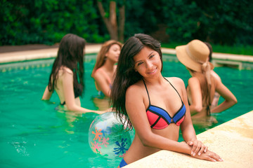 Happy young girls in pool