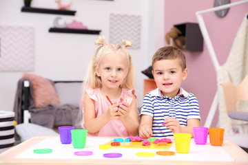 Cute little children modeling from playdough at home