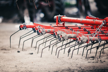 Fototapete - steel roller for a harrow stands in the field for agricultural work in the spring