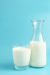 Bottle and glass of milk isolated