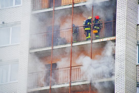 Russia, Saint-Petersburg - 28 march. High-rise condominium or apartment burning. Fire in apartments of a large tenement-house. Firefighters in gas masks rescue people from smoke and extinguish fire.