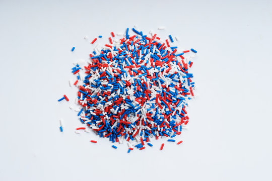 Sugar sprinkle dots in blue, white and red colors.