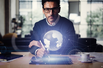 Wall Mural - Man with digital tablet and abstract hologram of a globe
