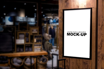 Mock up billboard advertising with black frame on wooden panel