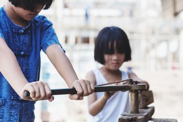 Forbidden Junior Porn - Children working at construction site for world day against children labour  concept: