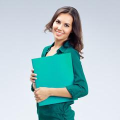 Businesswoman with folder, on grey