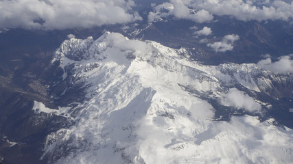 The Presolana mountain seen from the window of the plane in the spring with still a lot of snow