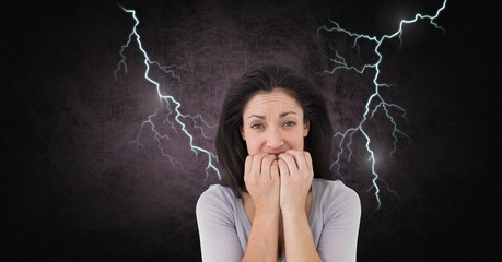 Lightning strikes and scared afraid woman biting nails