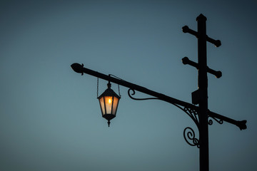 vintage street lantern against a dark sky