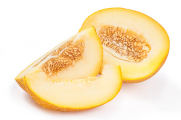 Slices sweet yellow melon with seeds isolated over white background