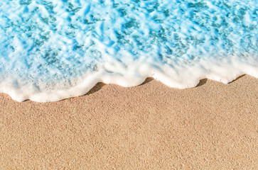 Soft Wave of Blue ocean in Summer.  Empty Sandy Beach  Background with copy space for text..