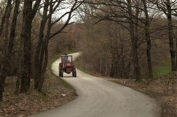 Tractor driving on forest path