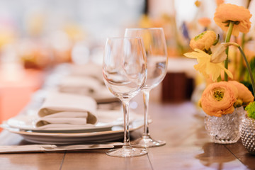 Served dinner table in a restaurant. Restaurant interior. Cozy restaurant table setting. Defocused background
