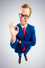 Businessman in glasses showing okay gesture or zero