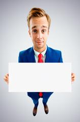 Businessman showing blank signboard