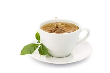 Fototapete - cup of tea with leaves and drop splashing, on white background