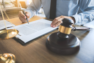 lawyer working with documents at a courtroom