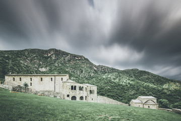 church in  mountain landscape - spring mood - desaturated style image