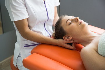 Physiotherapist giving massage to a woman