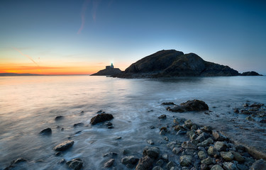 Wall Mural - Stunning sunrise over The Mumbles lighthouse in Swansea Bay on the south coast of Wales