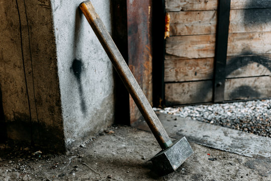 old sledgehammer standing in garage