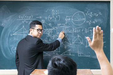 The teacher is teaching mathematics