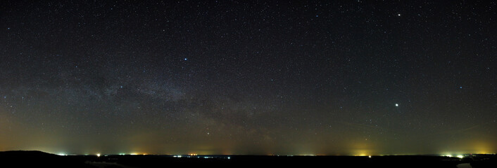 Night sky with the stars of the Milky Way galaxy. Panoramic view of the starry space.