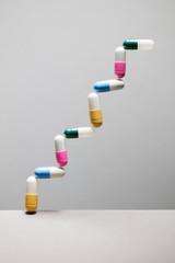 Medicine in graph shape to illustrate increase in medical drug use.
