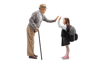 Mature man high-fiving a schoolgirl