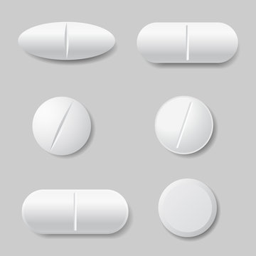 Set of vector illustrations of white medicine pills, round and oval - isolated