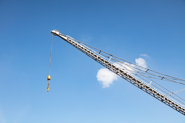 Crane boom and hook with sky background