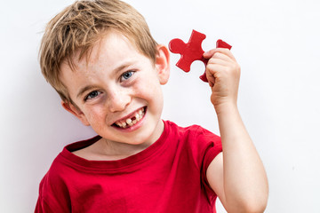 happy child finding jigsaw for concept of solution to healthcare