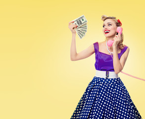 woman with money, talking on phone, dressed in pinup style