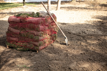 Pile of  grass rolls with shovel
