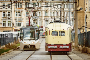Vintage and modern trams on the town street.