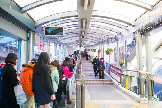 People move up on the escalator at the Central Hong Kong
