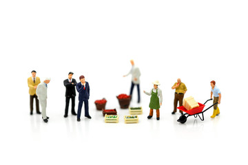 Miniature people : Businessman with market street,shopping business concept.