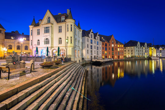 Architecture of Alesund town at night in Norway