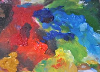 Closeup detail of oil color colorful artist palette tool
