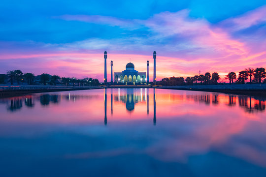 beautiful reflection mosque building shot during sunset or sunrise