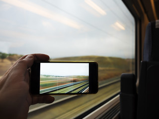 Taking photo through the window of the train