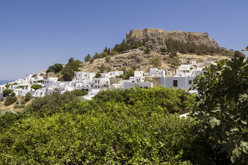 Panorama of a sunny day of Lindos with the castle above on the Greek Island of Rhodes.
