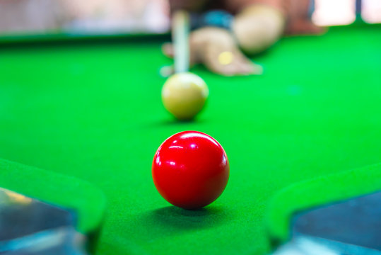Snooker is aim the cue ball focus on yellow ball on the table