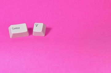 ctrl v keys on pink background