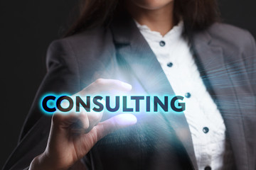The concept of business, technology, the Internet and the network. A young entrepreneur working on a virtual screen of the future and sees the inscription: Consulting