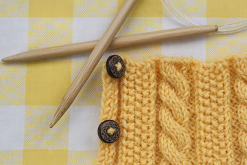 Knitting pattern and needles on a background