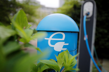A charging box for electric cars is pictured in front of the headquarters of the German power supplier RWE, which plans to break up subsidiary Innogy and share its assets with rival E.ON, in Essen