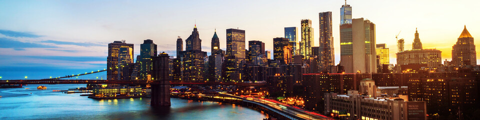 Aerial view on the city skyline in New York City, USA at night. Famous skyscrapers